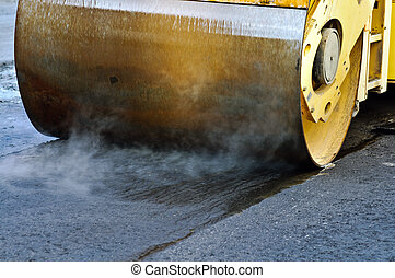 Heavy roller used during resurfacing of city street