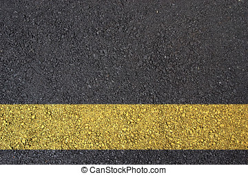 Asphalt surface with yellow line - Dark asphalt surface...
