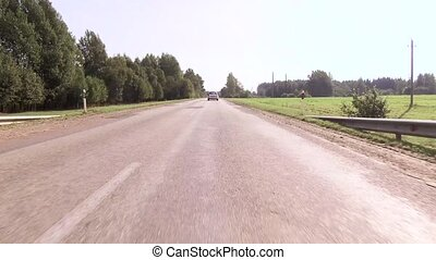 Asphalted country highway along the forest - Traffic on...