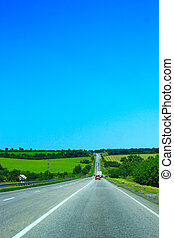 asphalted road and the blue sky