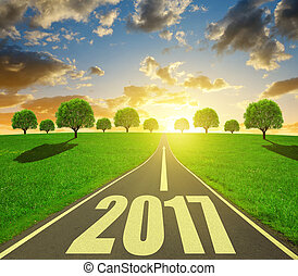 Forward to the New Year 2017 - Asphalted road at sunset. ...