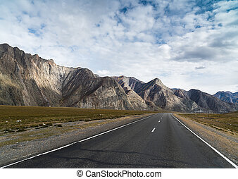 asphalted road with markings in the mountains