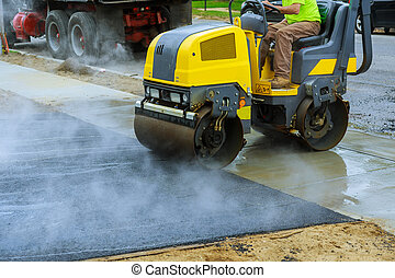 Asphalting construction works with commercial repair equipment road crews