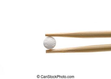 Aspirin - An aspirin in chopsticks.