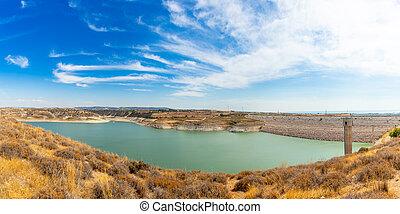 Asprokremmos reservoir fresh water lake panorama with blue sky, Paphos district, Cypros