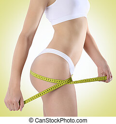 ass woman with tape for diet on a green background