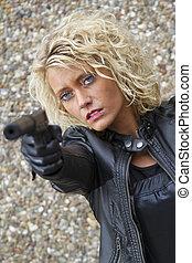 Assassin - Female assassin with a silencer handgun menacing...