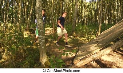 Assault Course - Two young men racing eachother over an...