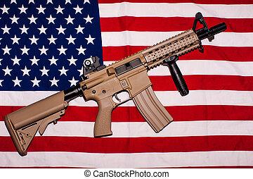 Assault rifle on american flag - AR-15 type assault rifle on...
