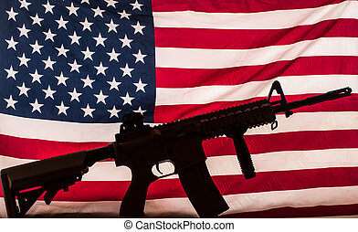 assault rifle on american flag - AR-15 type assault rifle...