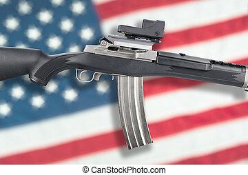Assault rifle over flag - An assault rifle isolated over an...