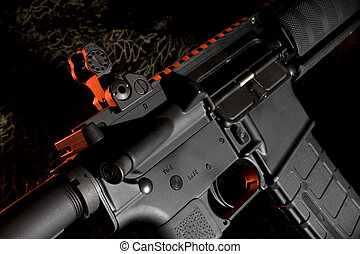 assault rifle - ar15 on a dark background with red...