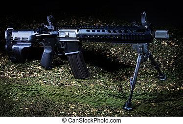 Assault rifle that is handgun length on green neeting