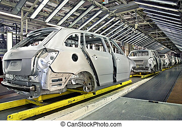 assembled cars in a row at car plant