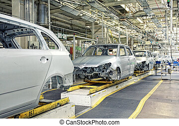 cars in a row at car plant - assembled cars in a row at car ...