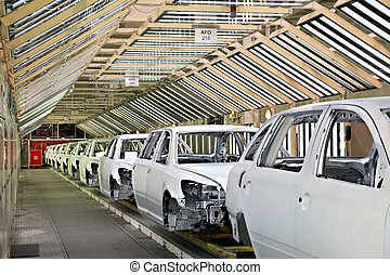 cars in a row at car plant - assembled cars in a row at car...