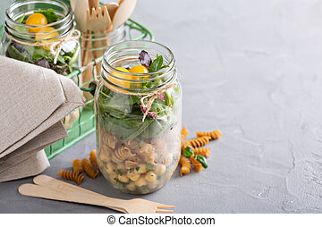 Assembling a mason jar salad for a lunch to go