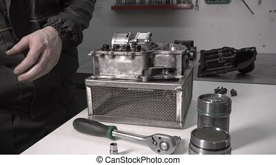 Assembling a modern automotive gearbox after replacing the...