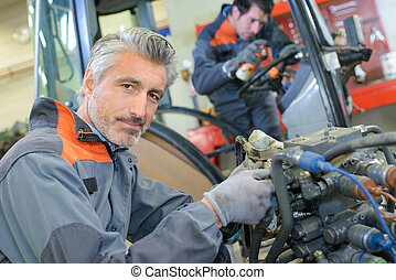 assembling a tractor