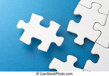 Assembling jigsaw puzzle pieces. - Concept image of...
