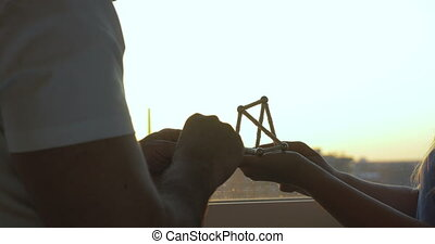 Assembling Magnetic Construction Set - Closeup shot of hands...
