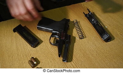 assembling of a pistol - fast action of assembling of a...