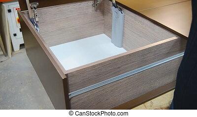 Assembling of furniture closeup - Assembling of furniture,...