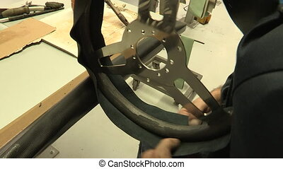 Assembly of leather steering wheel
