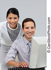 Assertive Asian businesswoman helping her colleague