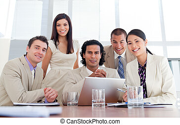 Assertive business partners working at a computer