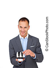 Assertive businessman consulting a business card holder...