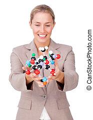 Assertive businesswoman showing a molecule