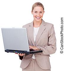 Assertive businesswoman using a laptop