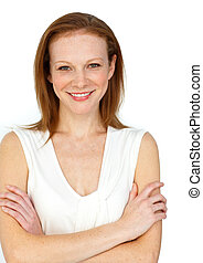 Assertive businesswoman with folded arms smiling at the...