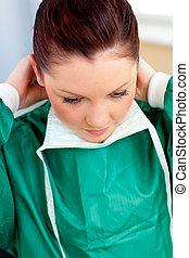 Assertive female surgeon wearing scrubs