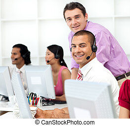 Assertive manager checking his employee\'s work in