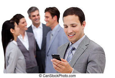 Assertive manager on phone standig in front of his team