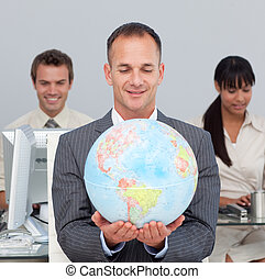 Assertive manager smiling at global expansion with his team...