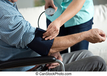 Assessment of blood pressure - Close-up of assessment...