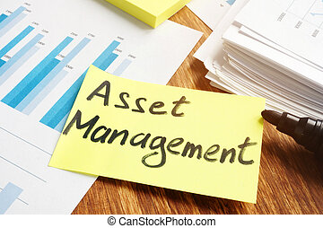 Asset management concept. Stack of business papers.