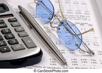 Assets - Photo of a Calculator, Pen, Eyeglasses and Balance...