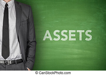 Assets text on blackboard - Assets text on green blackboard...