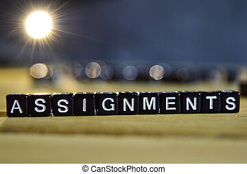ASSIGNMENTS concept wooden blocks on the table