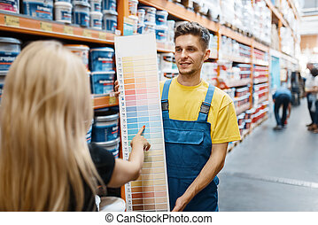 Assistant and female customer in hardware store
