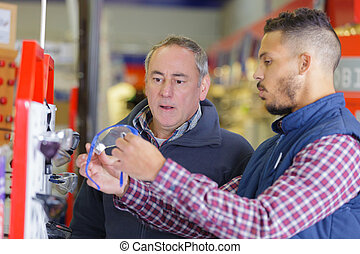 assistant with customer in diy hardware store