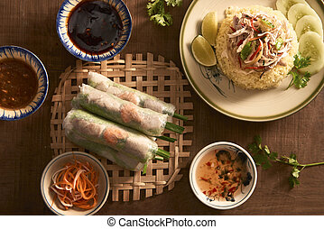 Assorted asian dinner, vietnamese food. Chicken rice, spring rolls