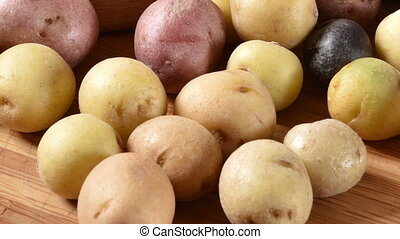 Assorted baby potatoes - Multi-colored tiny potatoes on a...