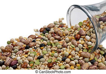 assorted beans spilled on the jar - Assorted beans spilled...