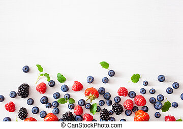 assorted berries over white background. blueberry, strawberry, raspberry, blackberry