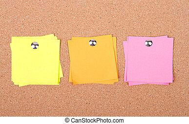 sticky notes on a bulletin board
